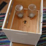 Inverted Canning Jars used to feed bees syrup over winter in Backyard Beekeeping
